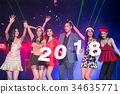 Young people are celebrating the night party entertainment. 34635771