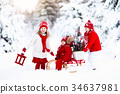 Children with Christmas tree. Snow winter fun 34637981