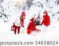 Children with Christmas tree. Snow winter fun 34638024