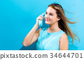Young woman with old fashioned phone 34644701