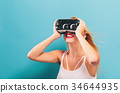 Young woman using virtual reality headset 34644935