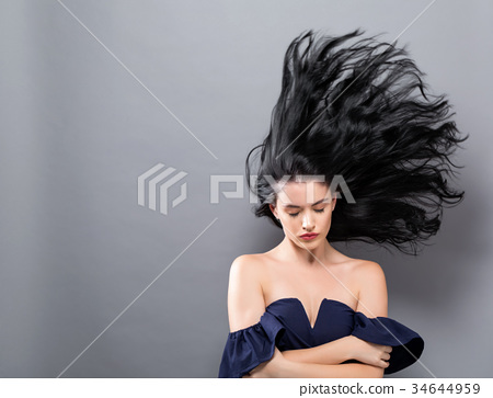 Young woman with floating hair  34644959