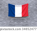 France flag hanging on brick wall. 34652477