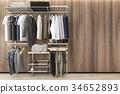 minimal scandinavian walk in closet with oak wall  34652893