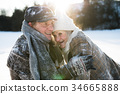 Beautiful senior couple on a walk in sunny winter 34665888