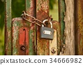 Old gat with padlock 34666982