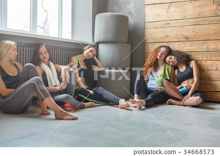 Young girls in sportswear having rest after 34668573