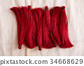 Red tassels line close up 34668629