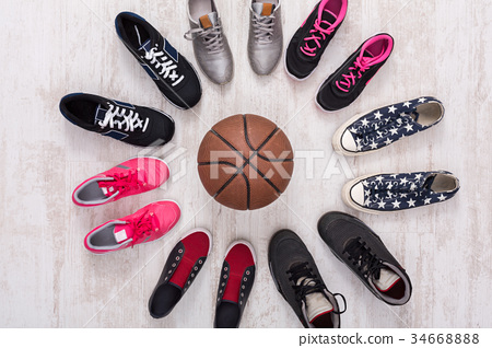 Colorful sport shoes circle with ball top view 34668888