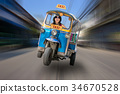 tricycle taxi rides on the streets of Bangkok 34670528