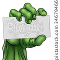 Zombie Monster Hand Holding Happy Halloween Sign 34679466