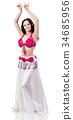 Beautiful girl dancing belly dance in pink dress. 34685956