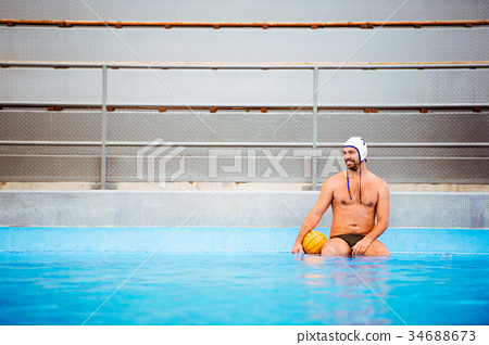 Water polo player in a swimming pool. 34688673