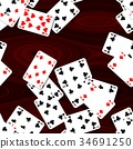 playing cards scattered on mahogany wooden table 34691250
