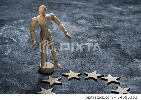 Wooden dummy stands outside the circle of stars 34693363