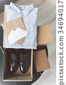 Different boxes with clothes and footwear 34694017