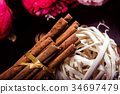 Ground cinnamon, cinnamon sticks, connected with a 34697479