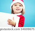 Happy toddler girl with Christmas gift box 34699675