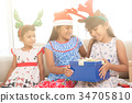 Happy Indian children on Christmas mood 34705810