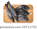 Fresh fish on wooden cutting board 34711735