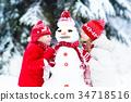 Kids building snowman. Children in snow Winter fun 34718516