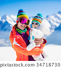 Family ski and snow fun in winter mountains 34718730