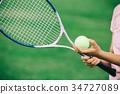 拿著網球和球拍的手 34727089