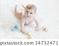 Cute baby girl playing with colorful pastel 34732471