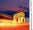 Famous Arc de Triomphe at night in Paris, France 34734657