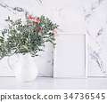 Blank frame and pink flowers over marble table 34736545