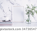 Blank frame and white flowers over marble table 34736547