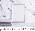 Blank frame and stack of fabrics over marble table 34736550