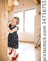 Cute little girl in dress and red high heels at 34736755