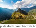 Machu Picchu illuminated by the sunset light 34739632