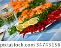 Delicious Mediterranean seafood shrimps and crawfish close up 34743156