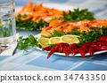 Delicious Mediterranean seafood shrimps and crawfish close up 34743350