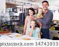Cheerful family of four shopping goods in household 34743933