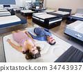 Couple choosing mattress 34743937