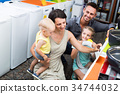 Glad family of four choosing washing machine 34744032
