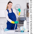 Young girl cleaning the room with mop 34744318