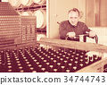 Positive wine maker unloads containers 34744743