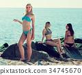 young woman in bikini standing on beach 34745670