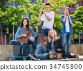 Cheerful girls and boys with musical instruments 34745800