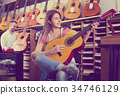 customers in music instruments shop 34746129