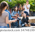 Friends musicians with instruments in park 34746199