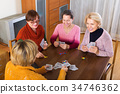 Women having fun with cards 34746362