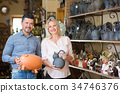 Couple in atelier with crockery 34746376