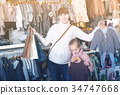 Pregnant female and child enjoying purchases 34747668