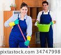 Professional cleaners at the work. 34747998