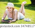 woman, lying, holding 34748517